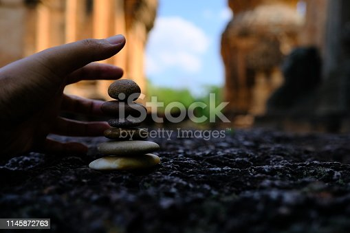 istock Zen stone at the ancient Cambodian ruins castle 1145872763