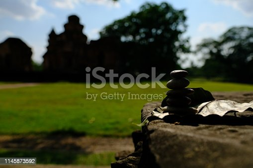 istock Zen stone at the ancient Cambodian ruins castle 1145873592