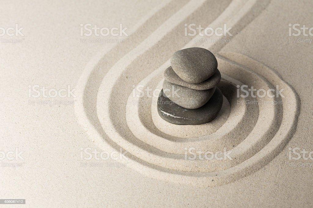 zen stone garden round stone and raked sand stock photo