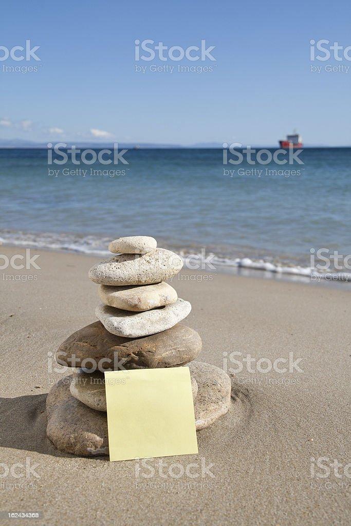 Zen stone little on beach. royalty-free stock photo