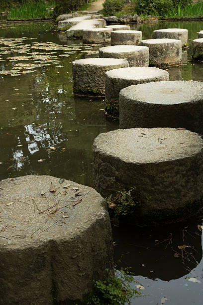 zen stone path in a pone near heian shrine - pone stock photos and pictures