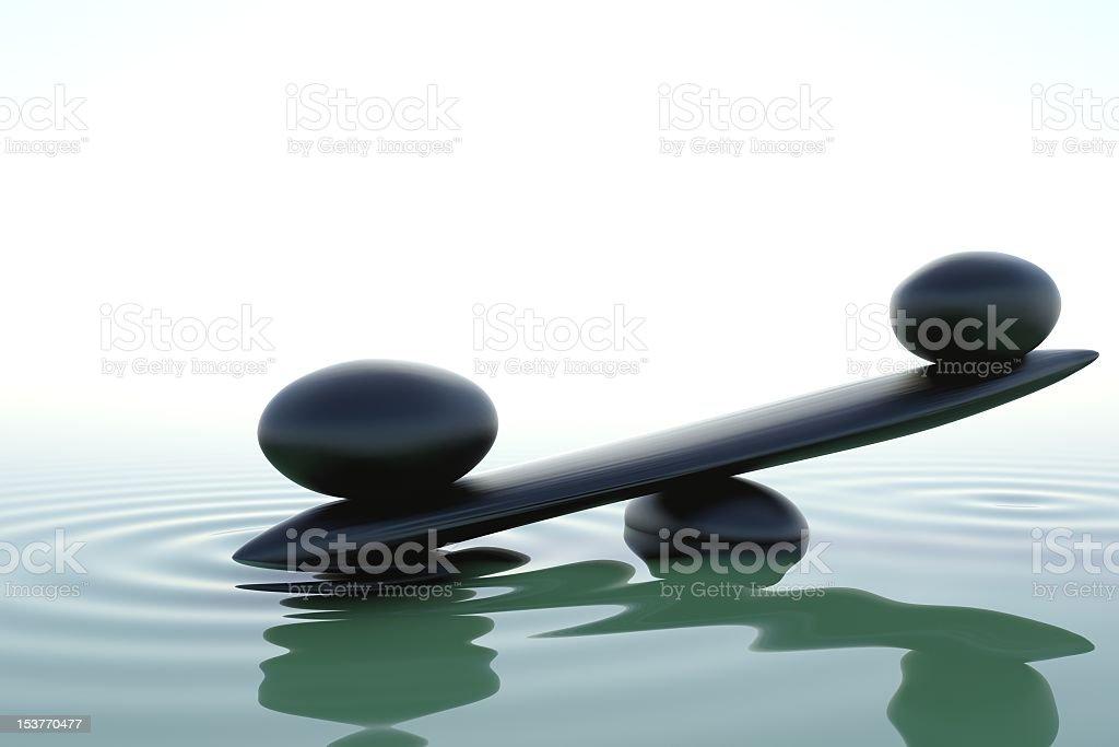 Zen stones balance in water stock photo