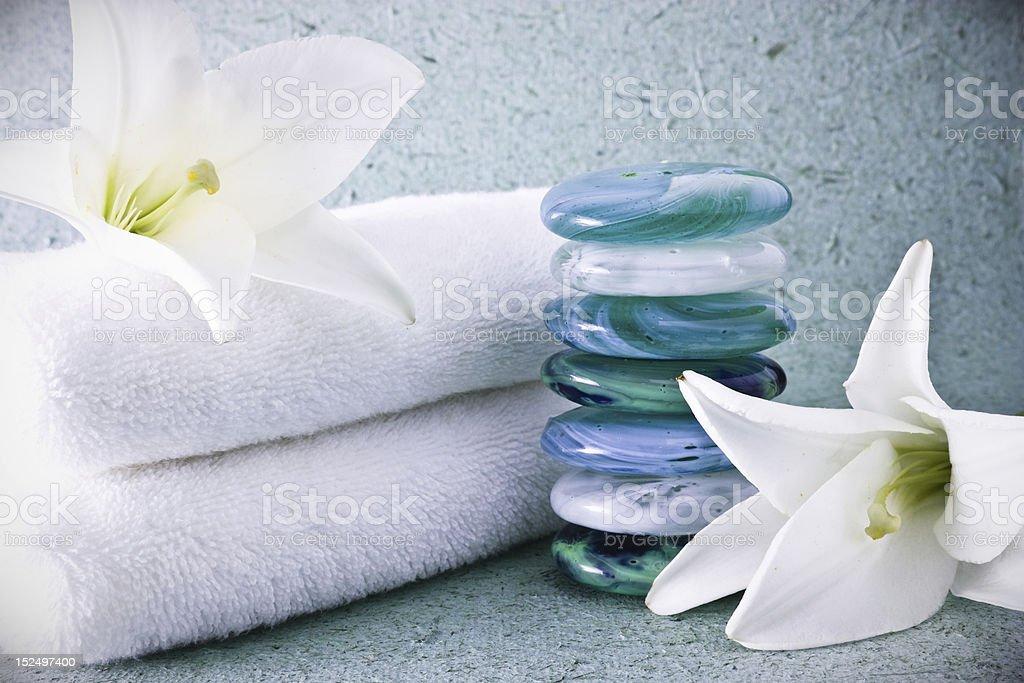 Zen stones, flowers, towels. royalty-free stock photo
