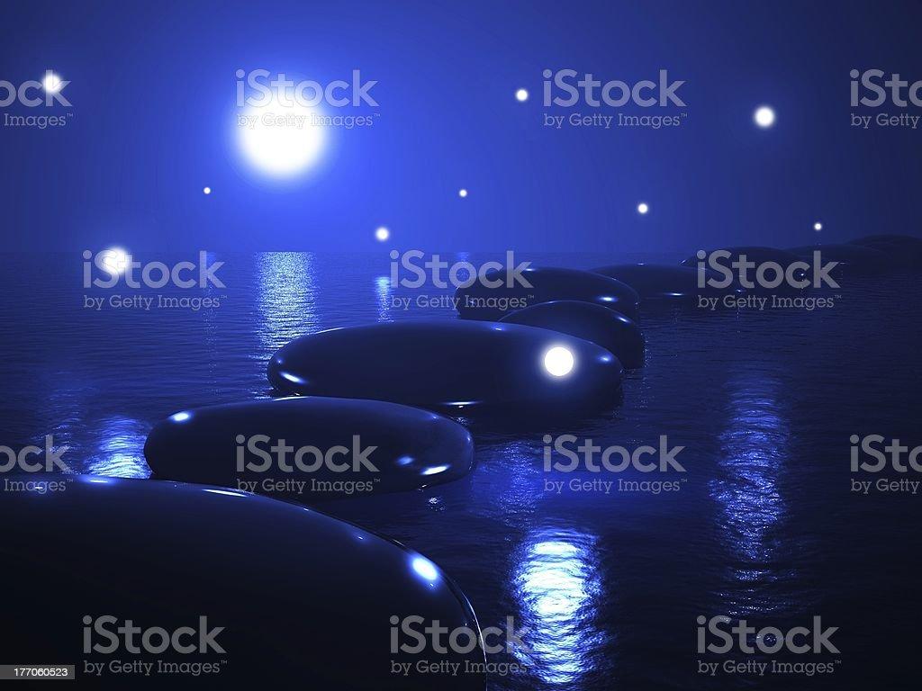 Zen stones in water, magic night royalty-free stock photo