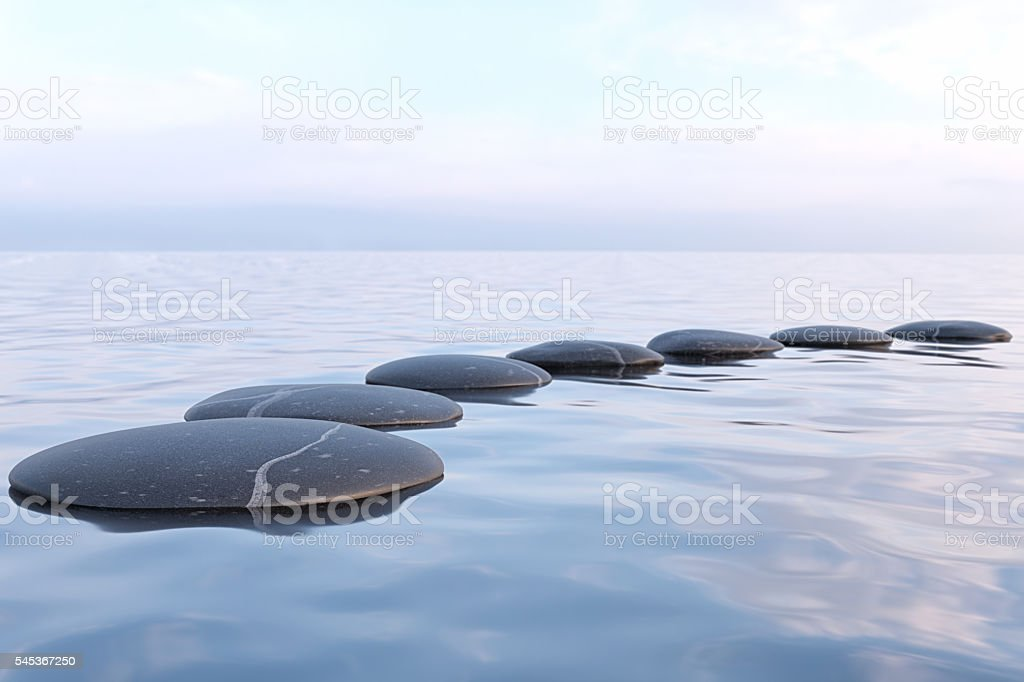 Zen stones in water stock photo