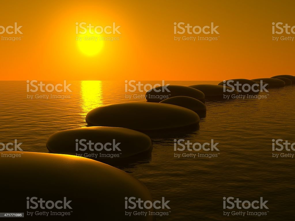 Zen stones in water, sunset royalty-free stock photo