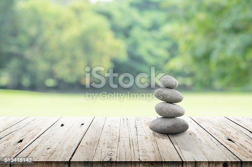 istock zen stones on wooden in the garden 513415142