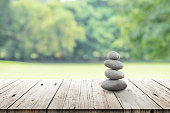 zen stones on wooden in the garden