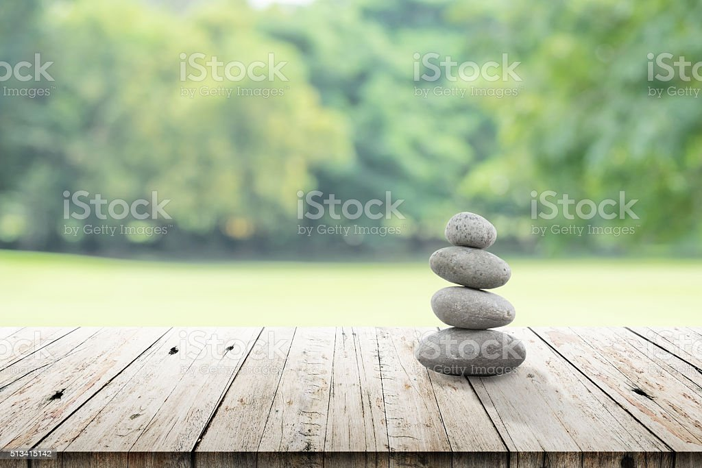 zen stones on wooden in the garden stock photo