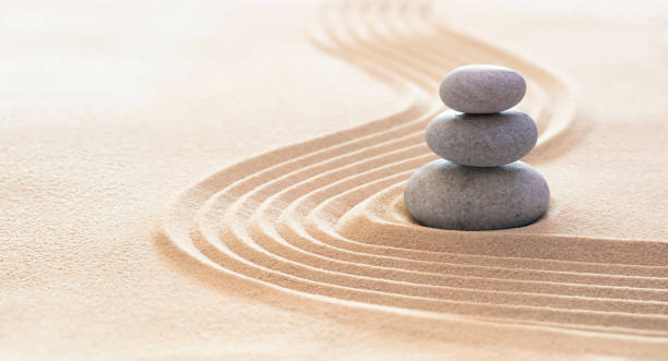 Zen Stones With Lines On Sand - Spa Therapy - Purity, Harmony And Balance Concept stock photo