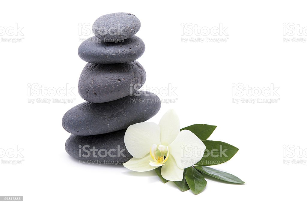 zen stones with orchids flower isolated. spa background royalty-free stock photo