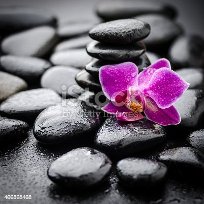 spa background with zen stones  and orchid .Others spa teme in this lightbox http://www.istockphoto.com/file_search.php?action=file&lightboxID=7989999