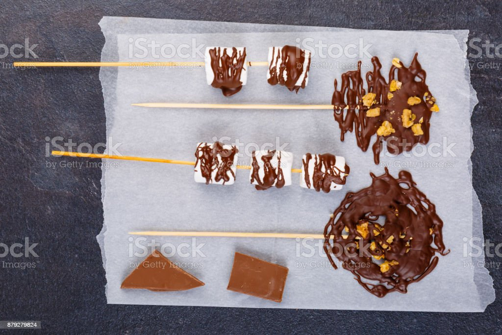 Zephyr on a stick in chocolate on a napkin stock photo