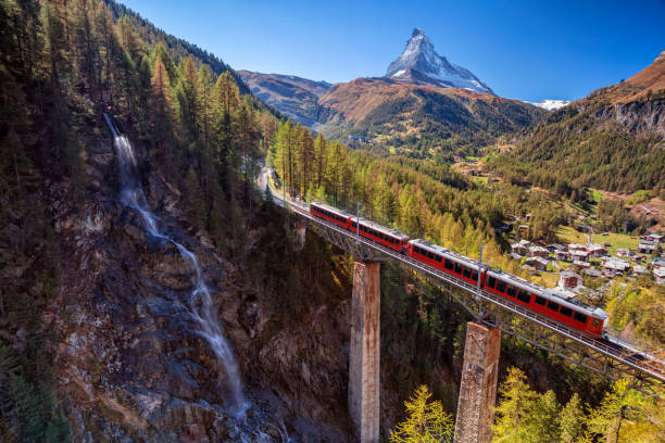 Zermatt, Switzerland. Image of Swiss Alps with Gornergrad tourist train, waterfall and Matterhorn in Valais region. switzerland stock pictures, royalty-free photos & images
