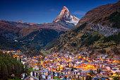 Image of iconic village of Zermatt, Switzerland with Matterhorn in the background during twilight.
