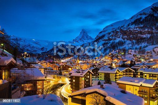World famous Zermatt town with Matterhorn peak in Mattertal, Valais canton, Switzerland, at dusk in winter. Taken by Sony a7R II, 42 Mpix.