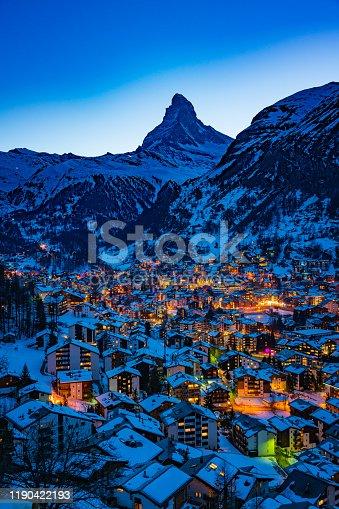 World famous Zermatt town with Matterhorn peak in Mattertal, Valais canton, Switzerland, at dusk in winter.