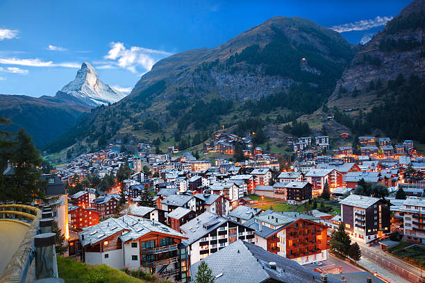 Zermatt village with view of Matterhorn in the Swiss Alps Famous Zermatt village with the peak of the Matterhorn in the Swiss Alps zermatt stock pictures, royalty-free photos & images