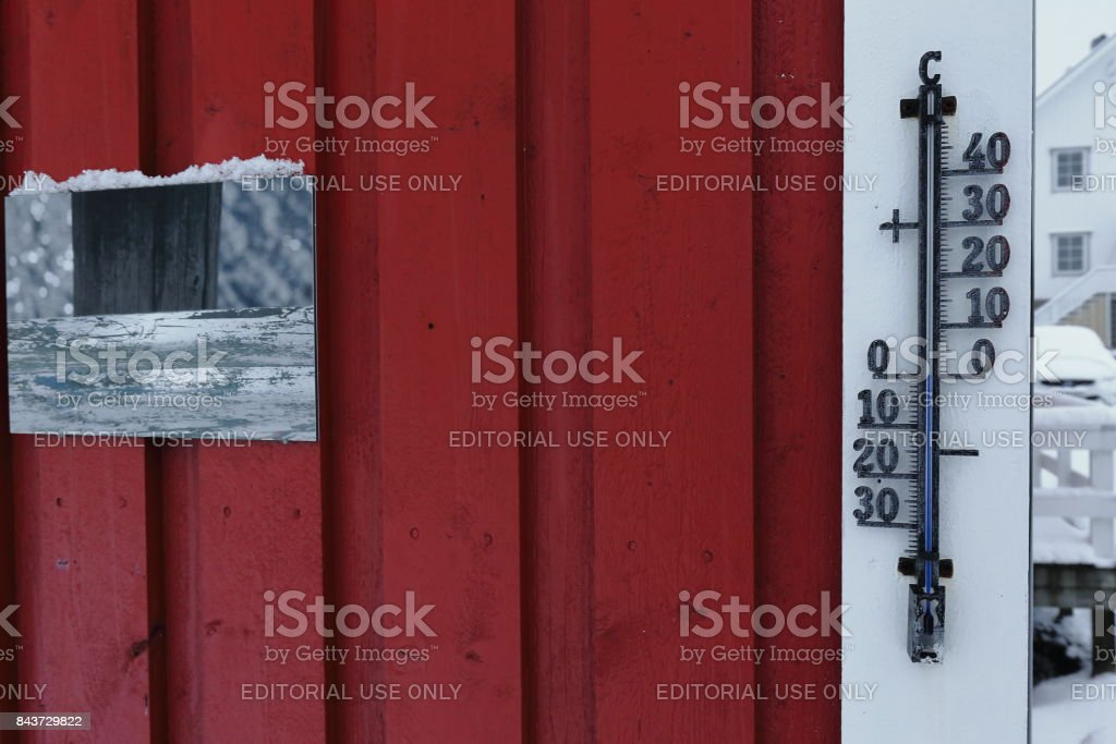 Zero degree temperature-thermometer on red wall of rorbu. Hamnoy-Reine-Moskenesoya-Nordland-Norway. 0369 stock photo