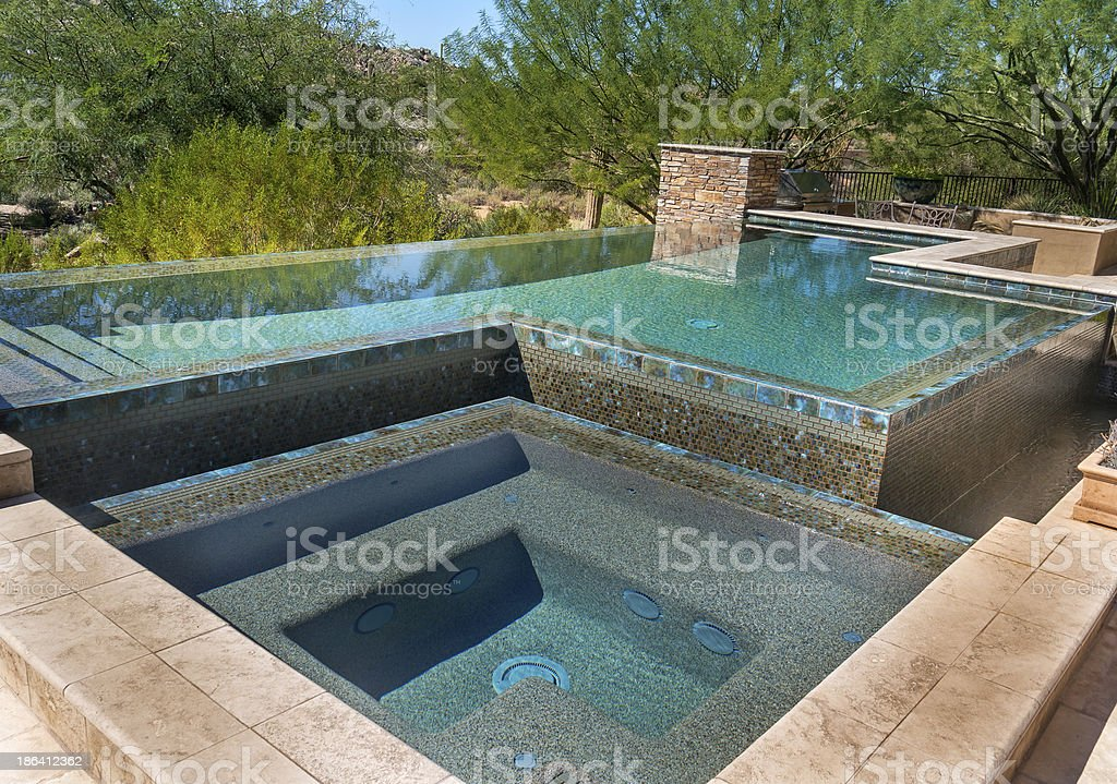 Zero horizon modern swimming pool royalty-free stock photo