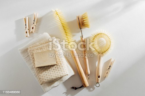 1168256931 istock photo Zero waste, compostable cleaning tools. Wooden dish brush and clothespins. Eco friendly concept. 1153489350