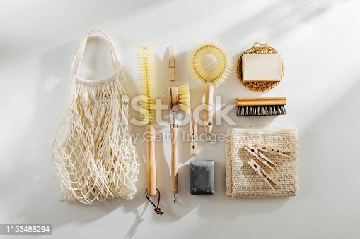 1169442284 istock photo Zero waste, compostable cleaning tools. Wooden dish brush, clothespins, soap and mesh market bag . Eco friendly concept. 1153488294