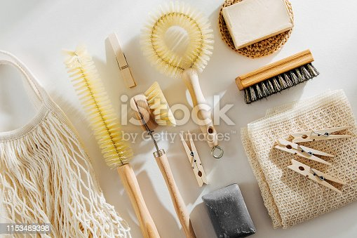 1169442284 istock photo Zero waste, compostable cleaning tools. Wooden dish brush, clothespins, soap and mesh market bag . Eco friendly concept. 1153489398