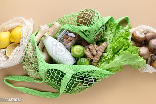 1126188273 istock photo Zero waste concept. Healthy vegan goods, mesh bag, eggs, ginger, vegetables. Stocks for rainy day. Top view. 1223379730