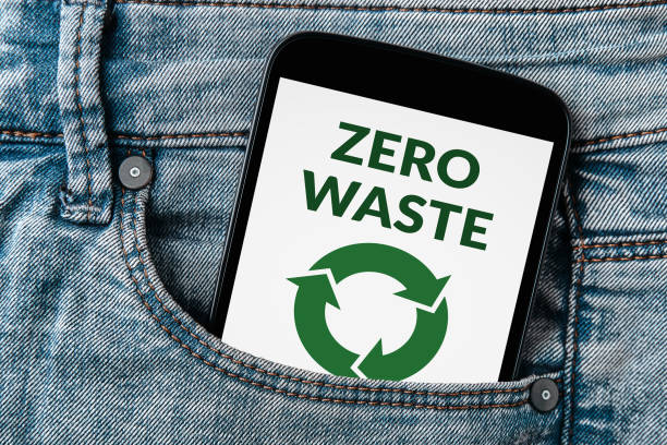 Zero waste concept on smartphone screen in jeans pocket stock photo