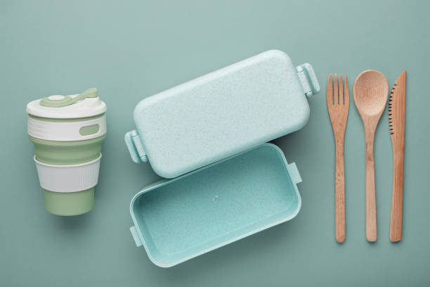 Zero waste lunch concept. Reusable cup and box, bamboo cutlery. Flat lay stock photo