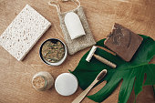 istock Zero waste, plastic free beauty essentials. Natural soap, solid shampoo in metal tin, reusable razor, crystal eco deodorant, toothpaste, sponge, bamboo toothbrush,ubtan on wooden background 1126877361