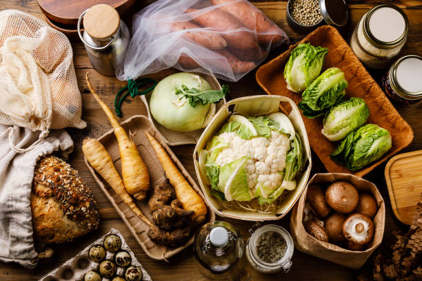 Zero waste Plastic free Compostable Eco friendly Various types of Packaging to buy foods on wooden background stock photo