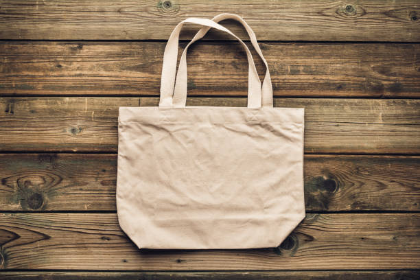 Zero waste, Recycling, Sustainable lifestyle concept. Eco-friendly cotton bag on wooden background stock photo