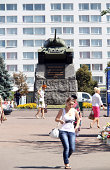 Zhytomyr, Ukraine - August 29, 2011:Central sqare in the city Zhytomyr, which is located 140 km south from Kiev. With war memorial in front of an old soviet style Zhytomyr hotel. There are also some local pedestrians in front of the monument - members of a local community.