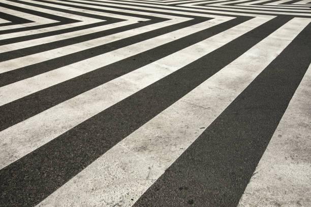 Zig zag crosswalk lines on the intersection concrete road stock photo