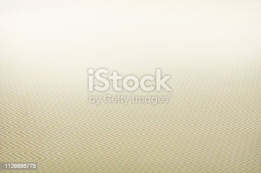 Ocher zigzag background with copy space