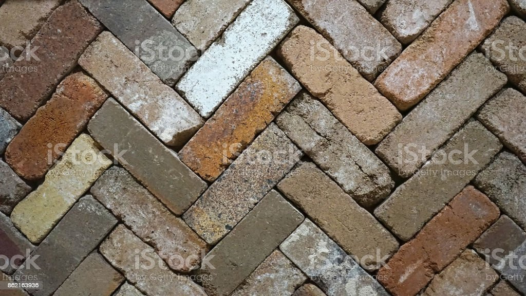 Zigzag diagonal lines of rustic color palette brick slabs stock photo