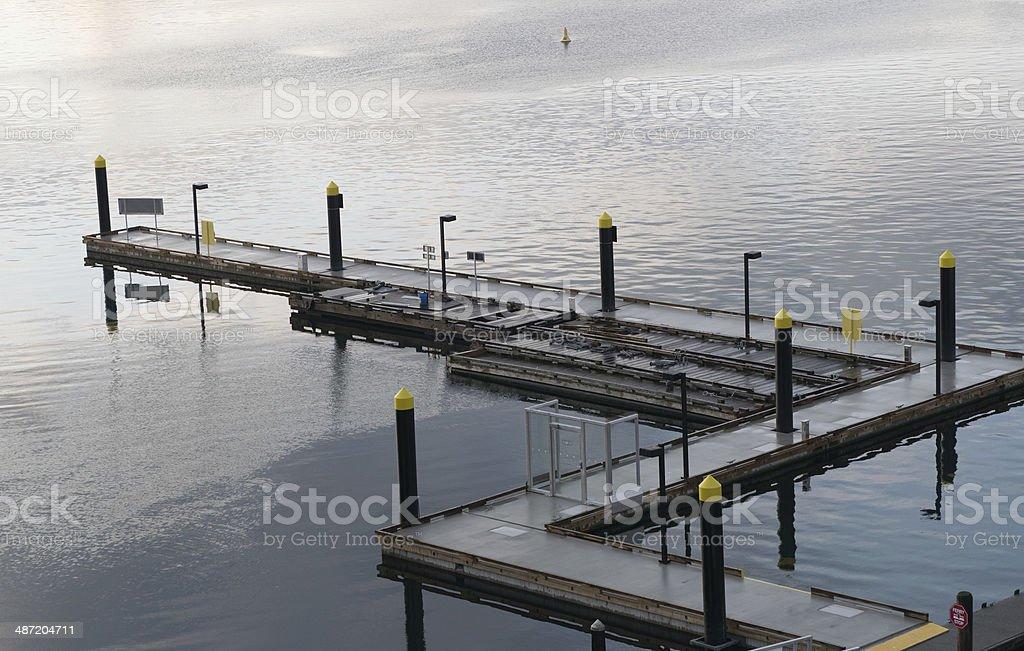 Zigzag dock on still water stock photo
