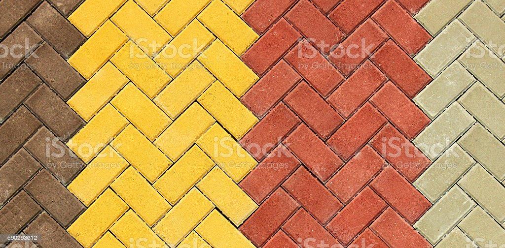 Zigzag pattern of colorful paving slabs close up royaltyfri bildbanksbilder