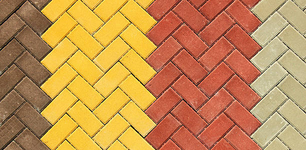 Zigzag pattern of colorful paving slabs close up stock photo