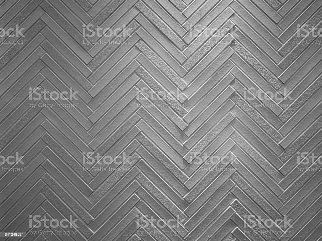 zigzag pattern of decorated concrete wall stock photo