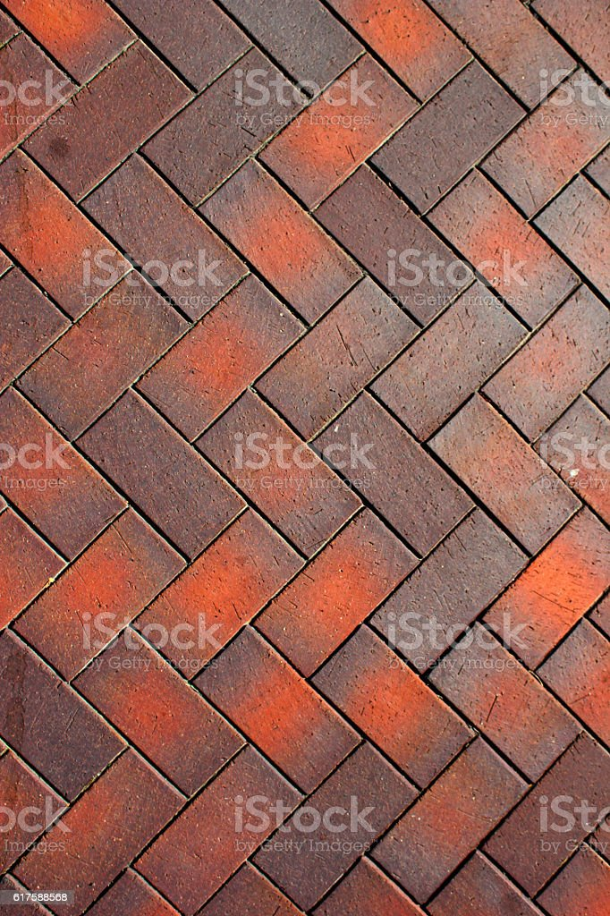 Zigzag pattern of red and brown paving tiles stock photo