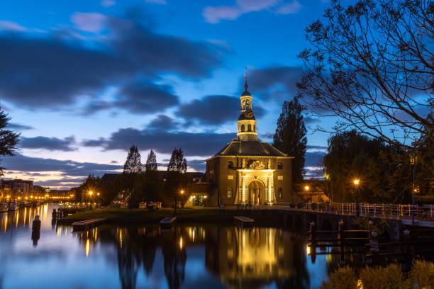 Zijlpoorts city gate in Leiden LEIDEN, THE NETHERLANDS - October 22, 2018: Medieval Zijlpoorts bridge and city gate during blue hour in Leiden, Holland, The Netherlands leiden stock pictures, royalty-free photos & images