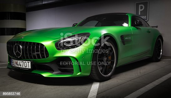 907671144 istock photo Zilina, Slovak Republik / Slovakia - November 09 , 2017: Native green colour Mercedes-AMG GT R Coupe standing at underground parking in Zilina, Slovakia 895853746