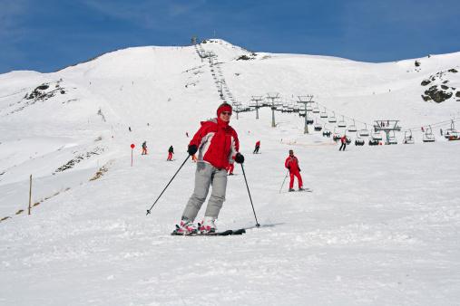 Zillertal, Austria - Woman on ski in the alps