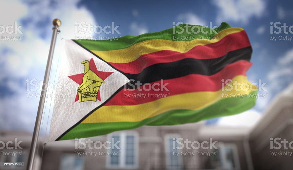 Zimbabwe Flag 3D Rendering on Blue Sky Building Background stock photo