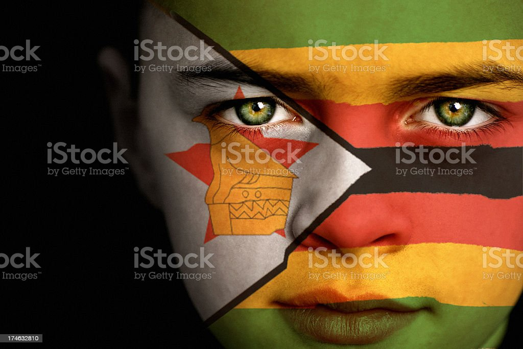 Zimbabwe flag boy royalty-free stock photo