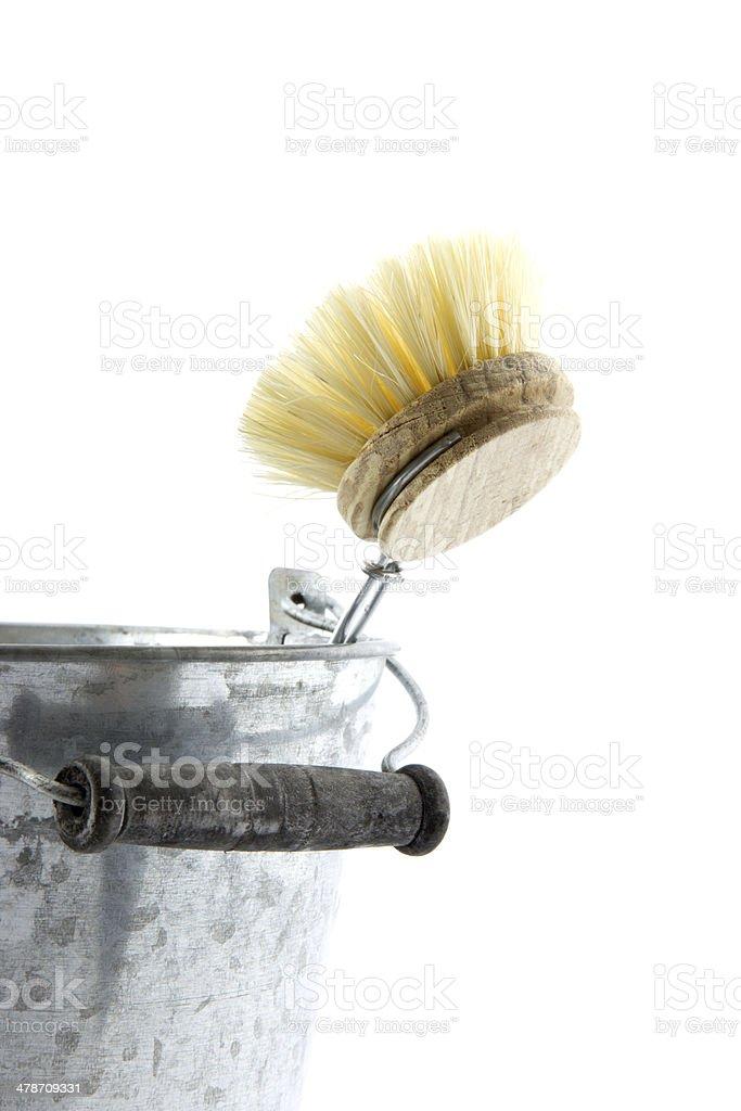 zinc bucket with washing-up brush stock photo