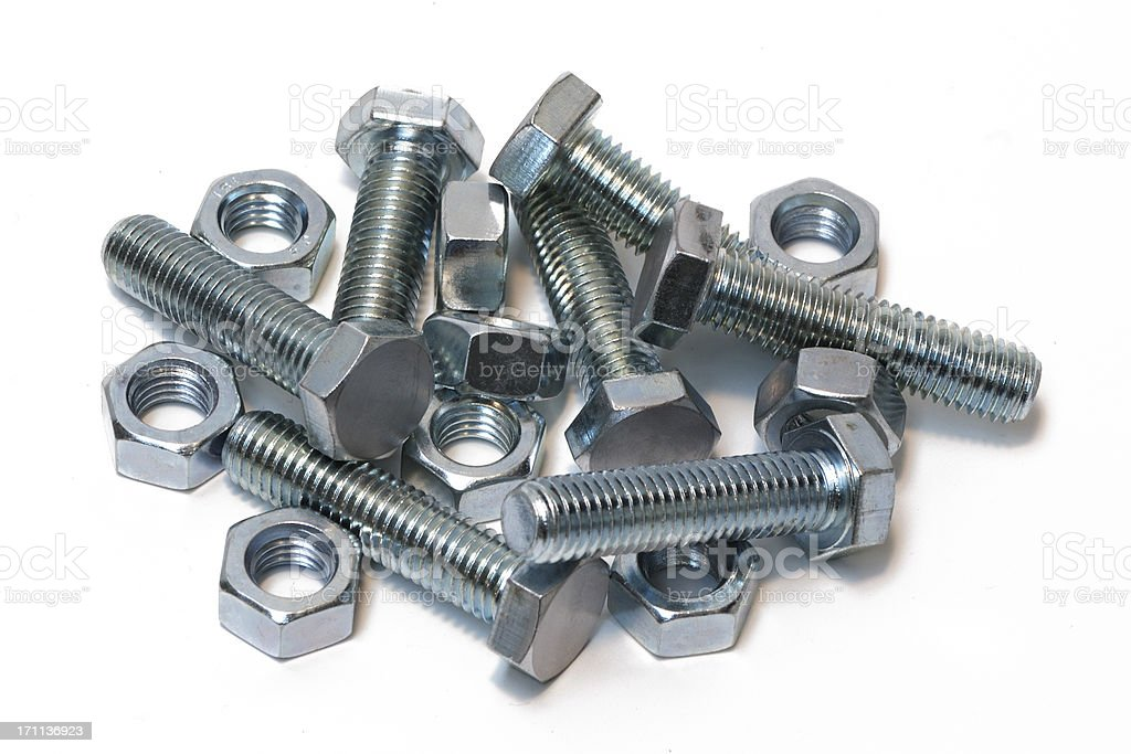 Zinc plated nuts and bolts isolated on white royalty-free stock photo