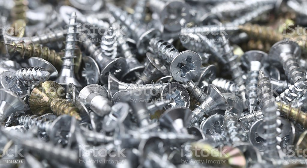 Zinked and anodized screws. royalty-free stock photo